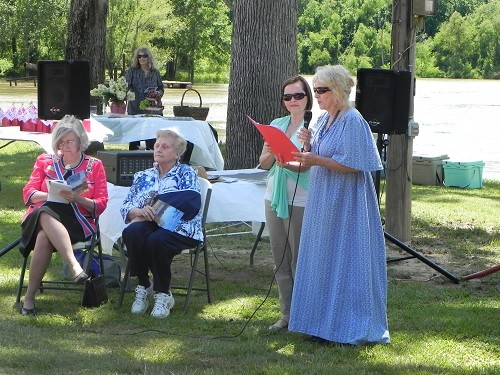 Claudia S. Campbell, right, chairman of the BCHDC Historic Marker Committee and regent with the Fort Mims Chapter of the Daughters of the American Revolution, presents text of the Tensaw Markers with Kelly Stewart.