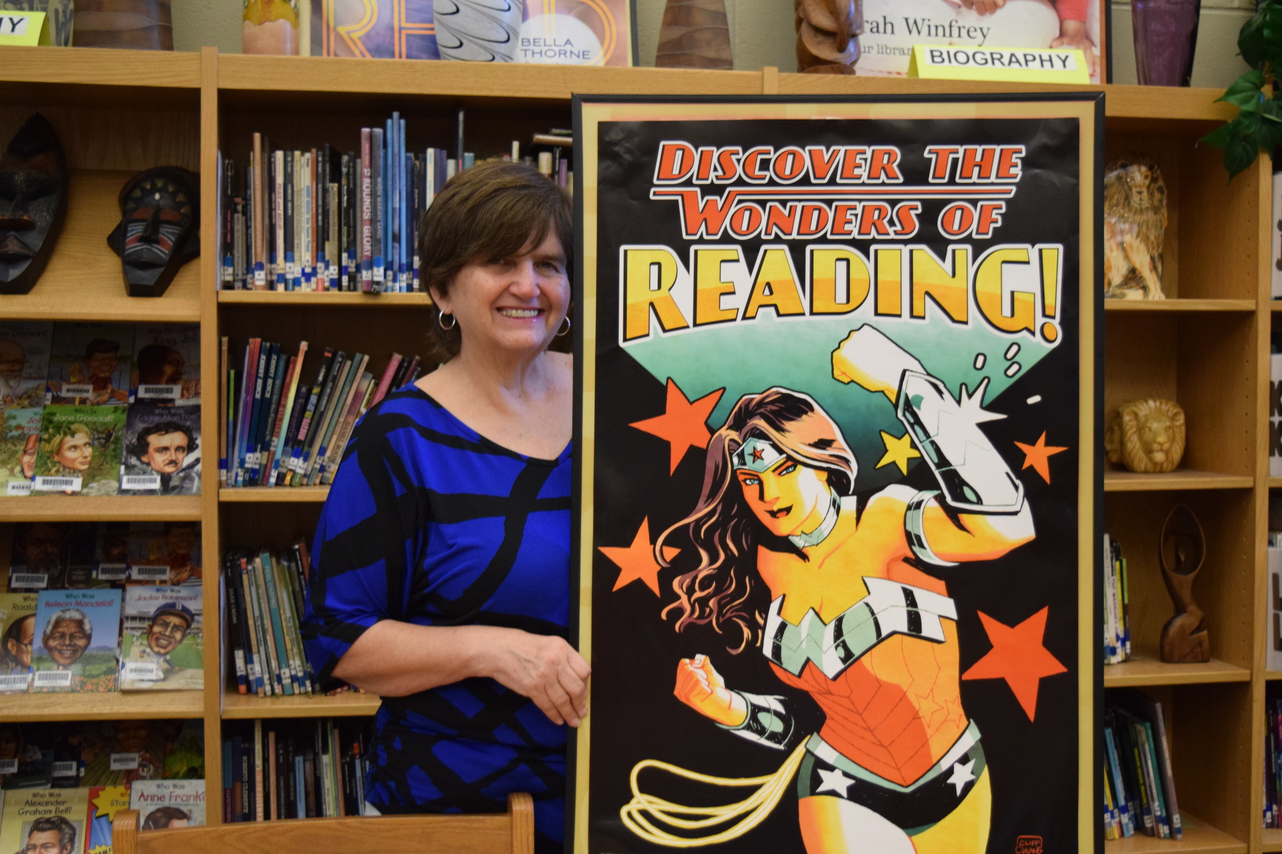 "Sue Norman, Foley Middle School Librarian, is one of the 13 winners of Capstone's ""The Power of Librarians"" contest. Her winning photo will appear in Capstone's 2018 calendar."