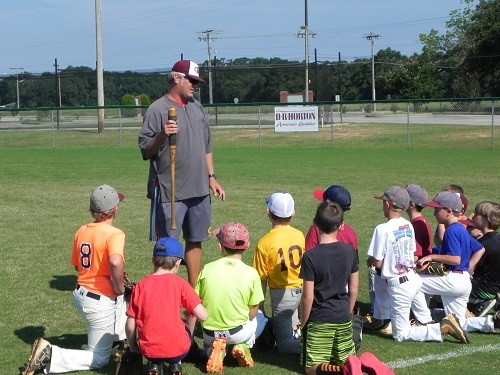RHS head baseball coach Peter Bezeredi lays out the rules during baseball camp Thursday.