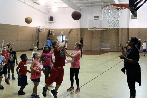RHS assistant girls coach A'Prell Knight works with younger campers.