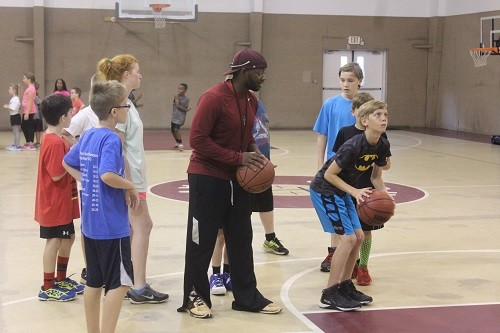 Mo Mitchell works with older campers.