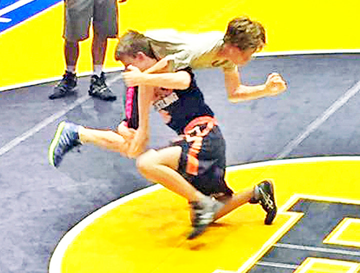 Tiger takedown: BCHS wrestlers polish competitive skill sets at summer clinic.