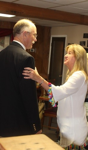 Baldwin County District Attorney Robert Wilters talks with Robertsdale City Council Member Ruthie Campbell.