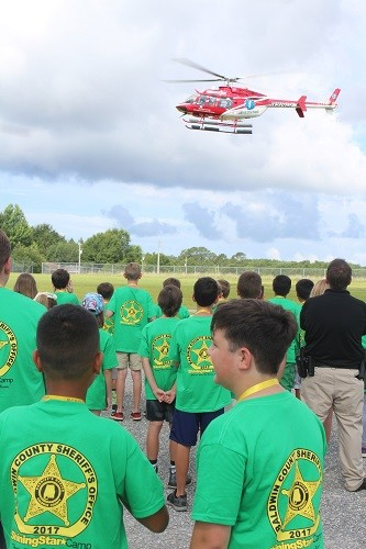 Campers watch as Medstar's Air Flight 1 lands at Magnolia School during the 2017 Baldwin County Sheriff's Office Shining Star Youth Camp on Wednesday.