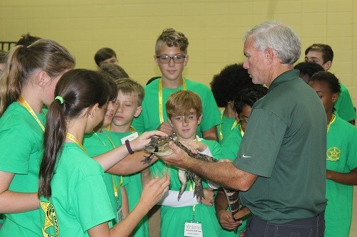 Campers get up close and personal with an alligator, brought by Wes Moore of Alligator Alley in Summerdale to the 2017 Baldwin County Sheriff's Office Shining Star Youth Camp Wednesday at Magnolia School.