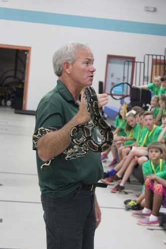 "Wes Moore gives campers a glimpse of ""Black Beard"" a common boa constrictor."