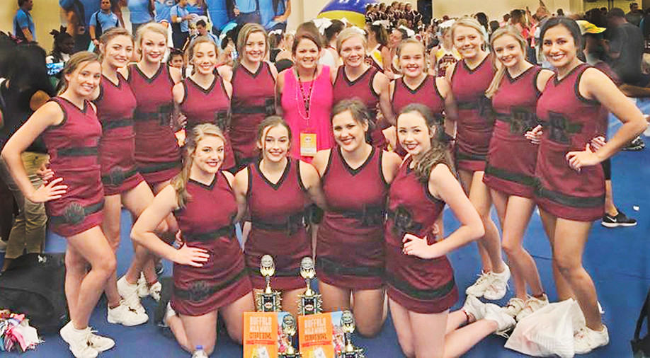 Robertsdale High School varsity cheerleading team: From left, back —  Maggie Moore, Tiler Coley, Anna Criswell, Camryn Lowery, Chloe Paul, Coach Amy Stewart, Jordan Darby, Kelsey Conner, Blakeley Mosley, Lanie Simmons and Jackie Landeros. From left, front — Seniors Taya Wilkinson, Maddy Feller, Elizabeth Smith and Kaitlyn Hanks.
