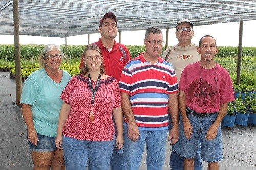 Program supervisor Charlene Sullivan with clients from ARC of Baldwin County who participate in its plant growing operation with Loxley's Flowerwood Nursery.