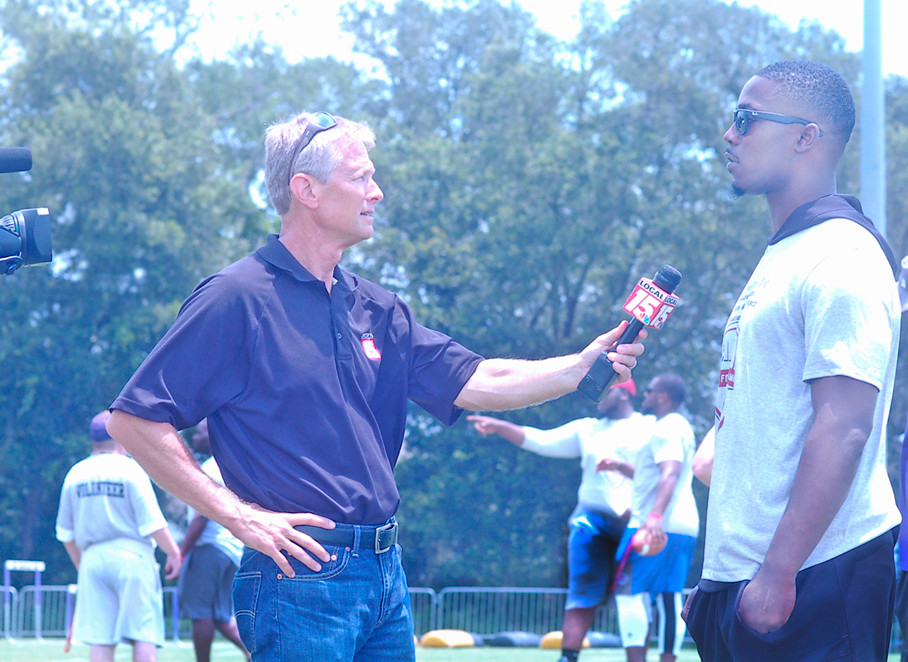 Jacksonville Jaguars running back T.J. Yeldon being interviewed Saturday by Lance Crawford, WMPI Sports Director at Al Trione Park.