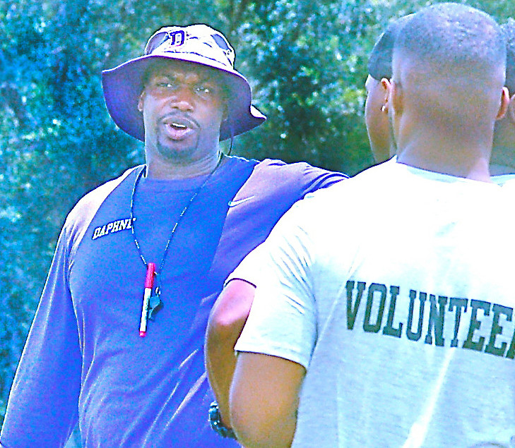 DHS head coach Kenny King directs volunteers before the camp.