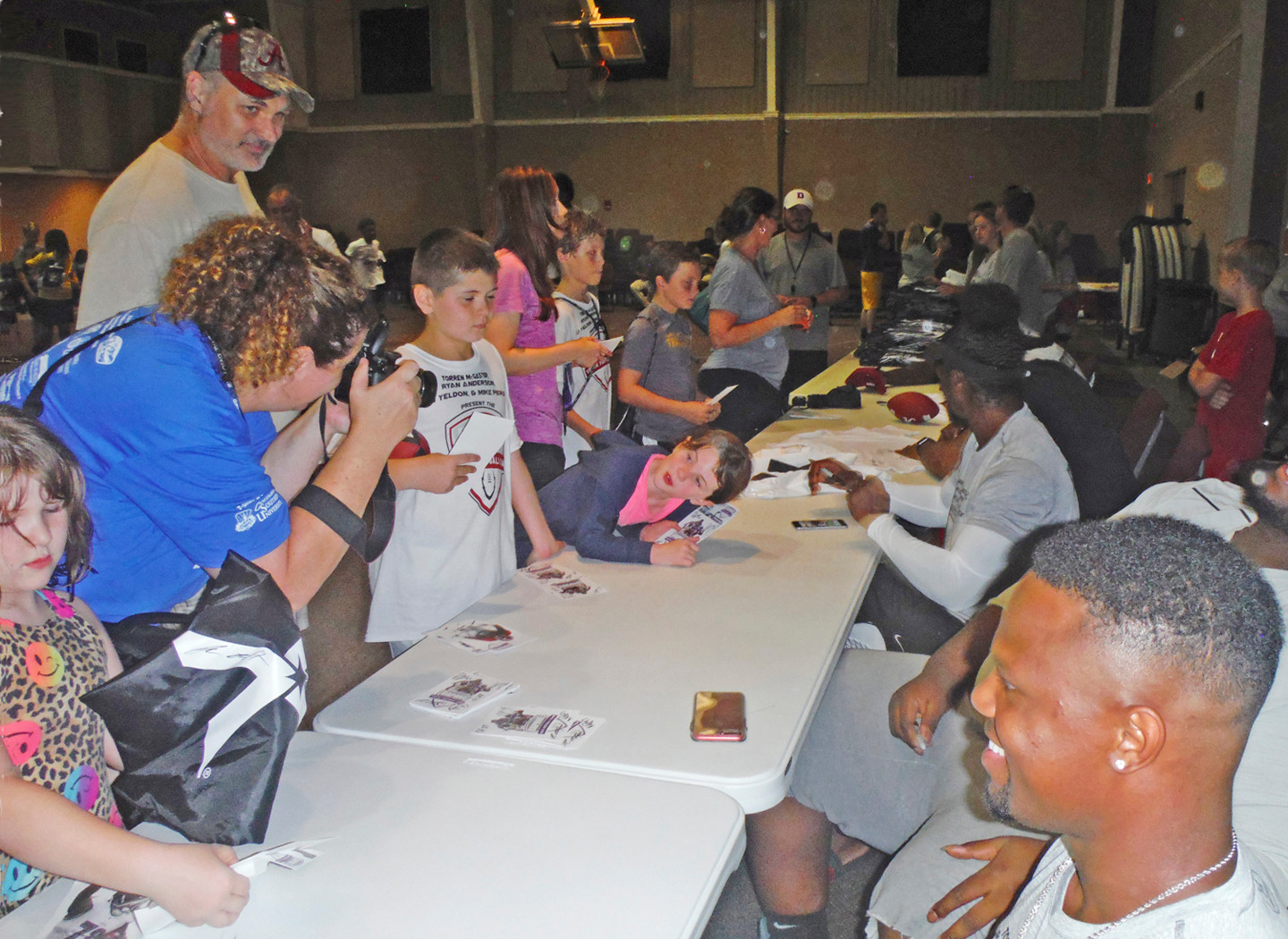 Meeting Cincinnati Bengals cornerback Torren McGaster and other players at Trojan Hall for autographs.