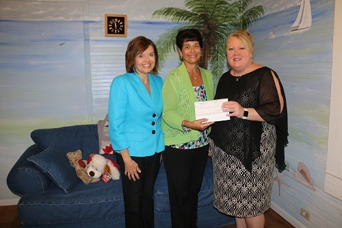 Beth Thomas, left, and Sharon Murrill with Alabama Power present at $10,000 donation to Niki Whitaker, right, executive director of the CARE House, Baldwin County Child Advocacy Center.