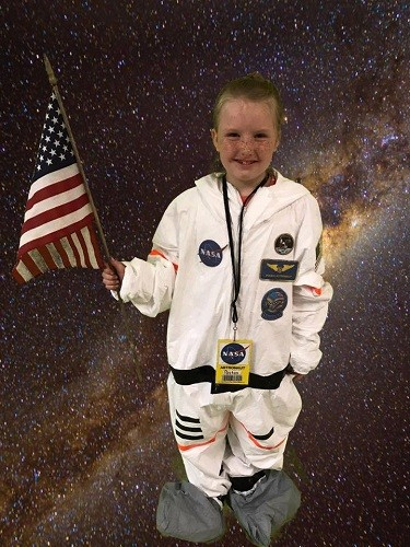 Payton Brown dons a space suit for a special photo session that was out of this world!