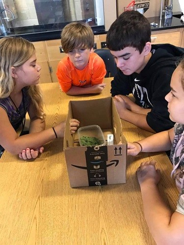 Campers build astronaut boxes to study moon sand and the different types of rock.
