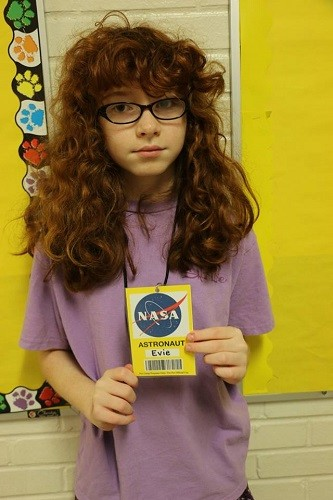 Young astronaut Evie Andrews shows off the badges worn by the campers each day.