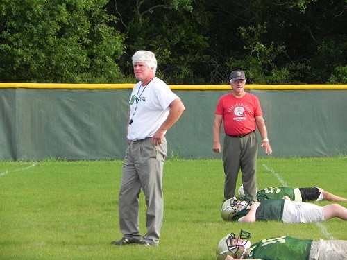 Snook Christian Academy Head Coach Keith Smith and father, legendary Foley Coach Lester Smith, who will serve as quarterbacks' coach for the team, oversee warm ups during Monday's practice.