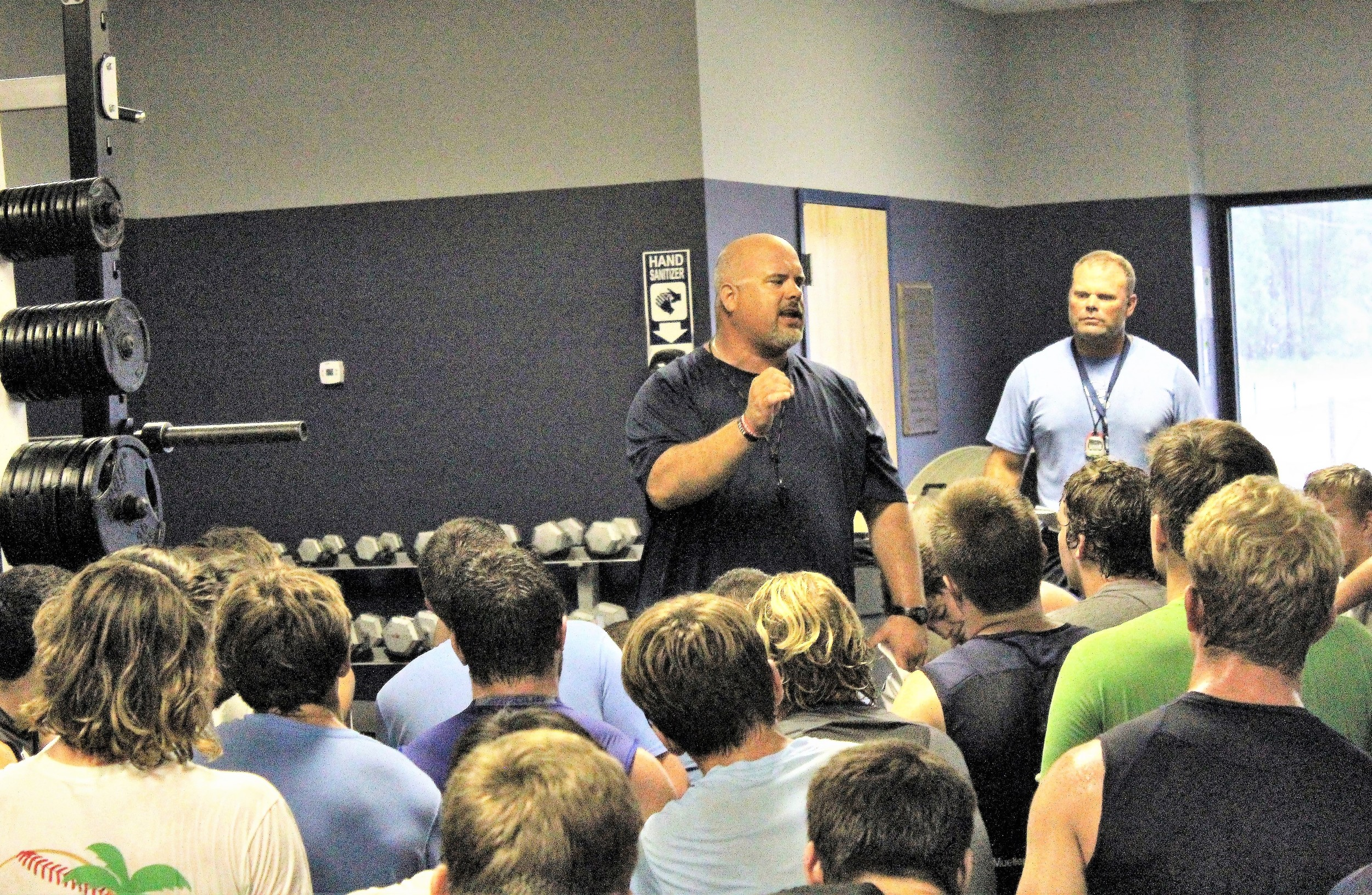 Dolphins head coach Matt Blake addresses his players at Gulf Shores High.