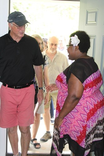 New home owner Kassie Betts greets visitors following a celebration and blessing ceremony held Wednesday, July 26 with Habitat for Humanity of Baldwin County in Bay Minette.