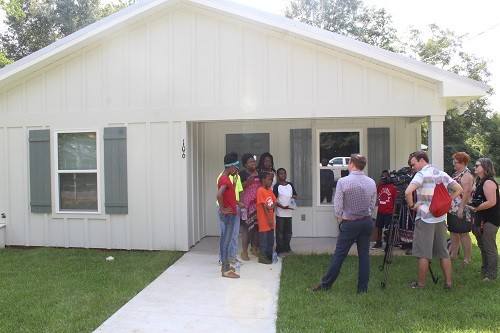Kassie Betts and family are interviewed by a local television station on Wednesday, July 26 following a celebration and blessing ceremony with Habitat for Humanity of Baldwin County.