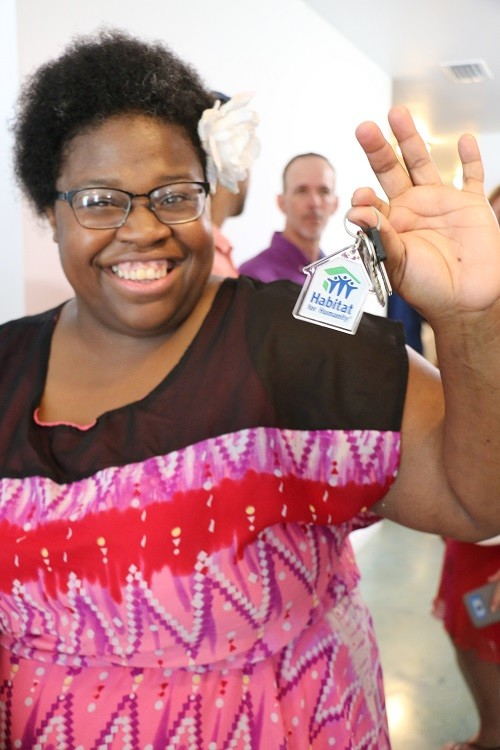 Kassie Betts shows off the keys to her new home in Bay Minette following a celebration and blessing ceremony with Habitat for Humanity of Baldwin County.