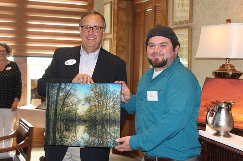 "Corey McDonald of Monroeville receives a special President's Award from CEO Robert Jones for his photo ""Swamp."""