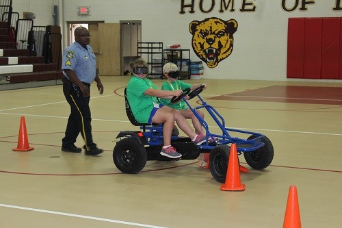 Campers experience what it's like driving while wearing special goggles to simulate alcohol and marijuana impairment during an alcohol awareness talk by Daphne Police Department school resource officer Jamie Huffman.