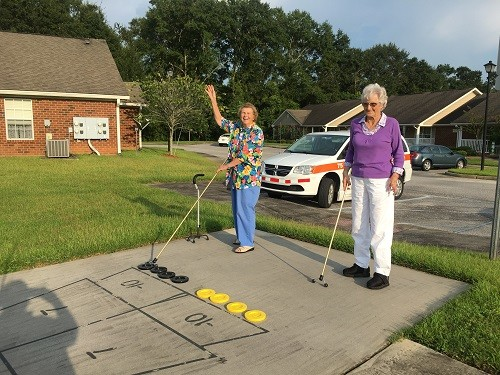 Dale Stanton, left, and Mary Fuller practice for the Master's Games at the George P. Thames Senior Center in Robertsdale.