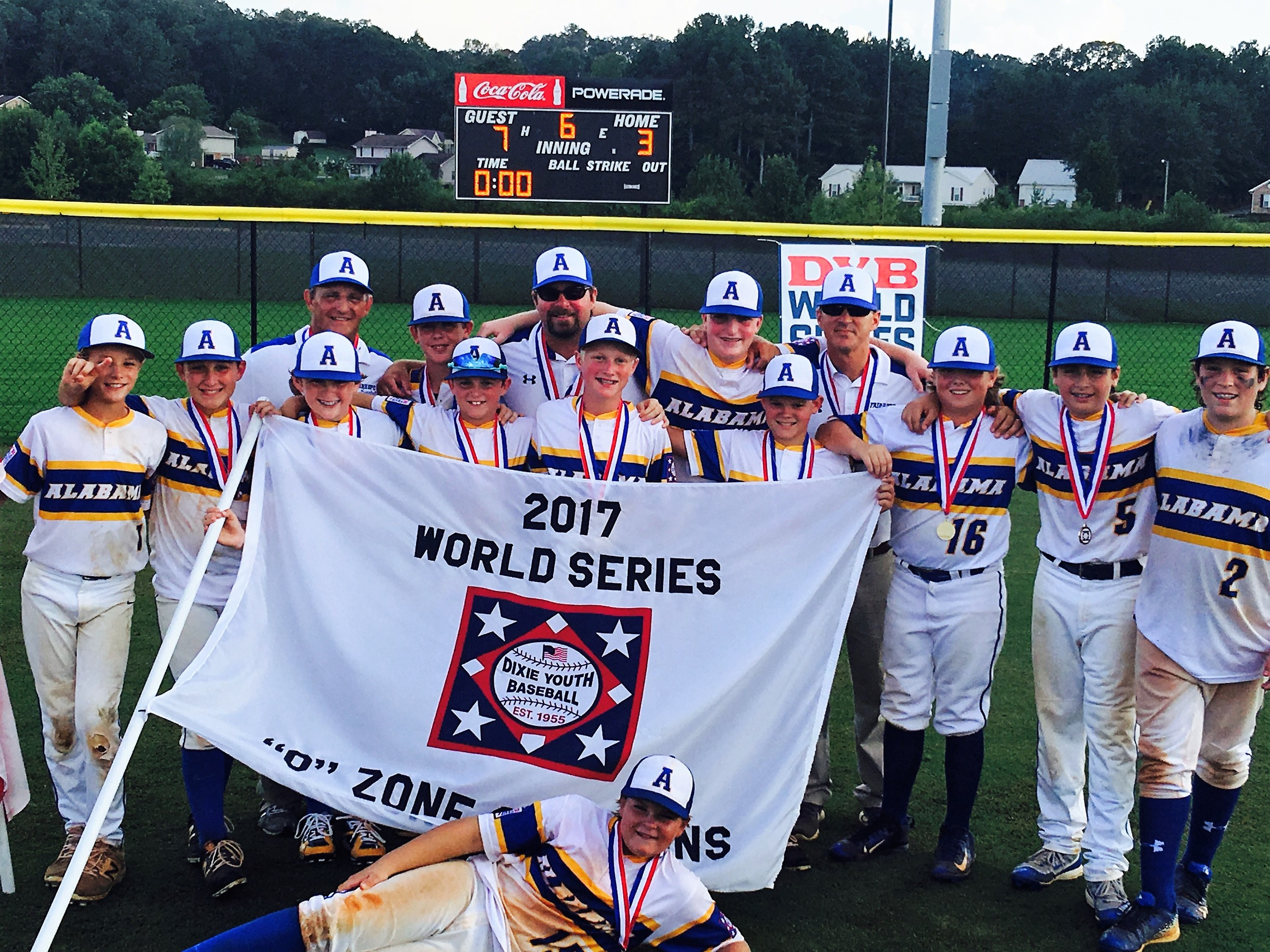 World Champs! Team Alabama - Fairhope American Ozone All Stars with 2017 championship banner and trophy. The team members include: Brooks Brasfield, Hollon Brock, Mikael Bryant, Caden Creel, Cory DeVole, Josh Gunther, Jackson Hatcher, John Malone, Riley Malone, Cade Morris, Gatlin Pitts and Steele Sims. The team is led by manager Andy Malone and assistant coaches Mike Pitts and Ryan Creel.