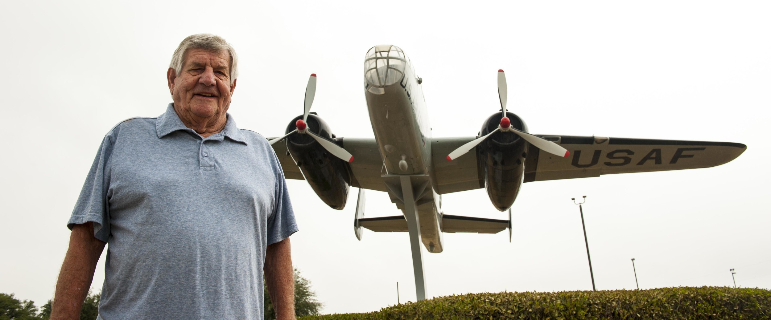 Russel Sharp stands in front of the B-25 aircraft he served on as crew chief and flight engineer during the 1950s.