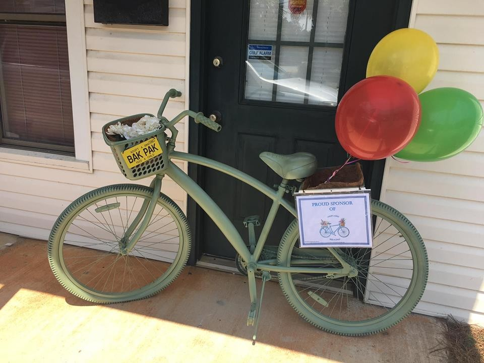 A Specialty Bakery's adopted bike sits outside the store to educate passerbys of the need in our community.