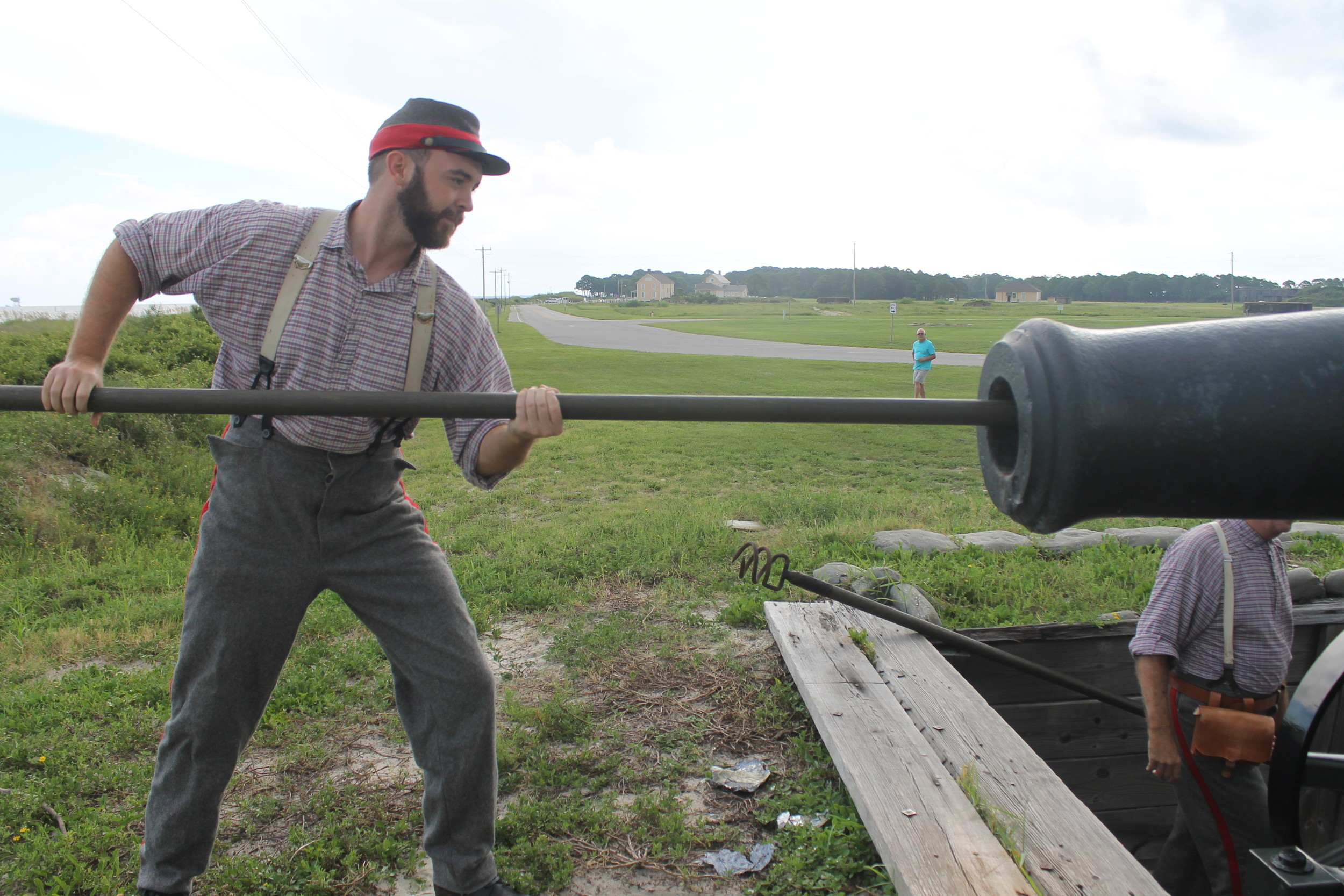 Siege 1: Dylan Tucker, cultural resource specialist at Fort Morgan, prepares the seacoast gun before it is fired at Fort Morgan. This week marks the 153rd anniversary of the Siege of Fort Morgan.