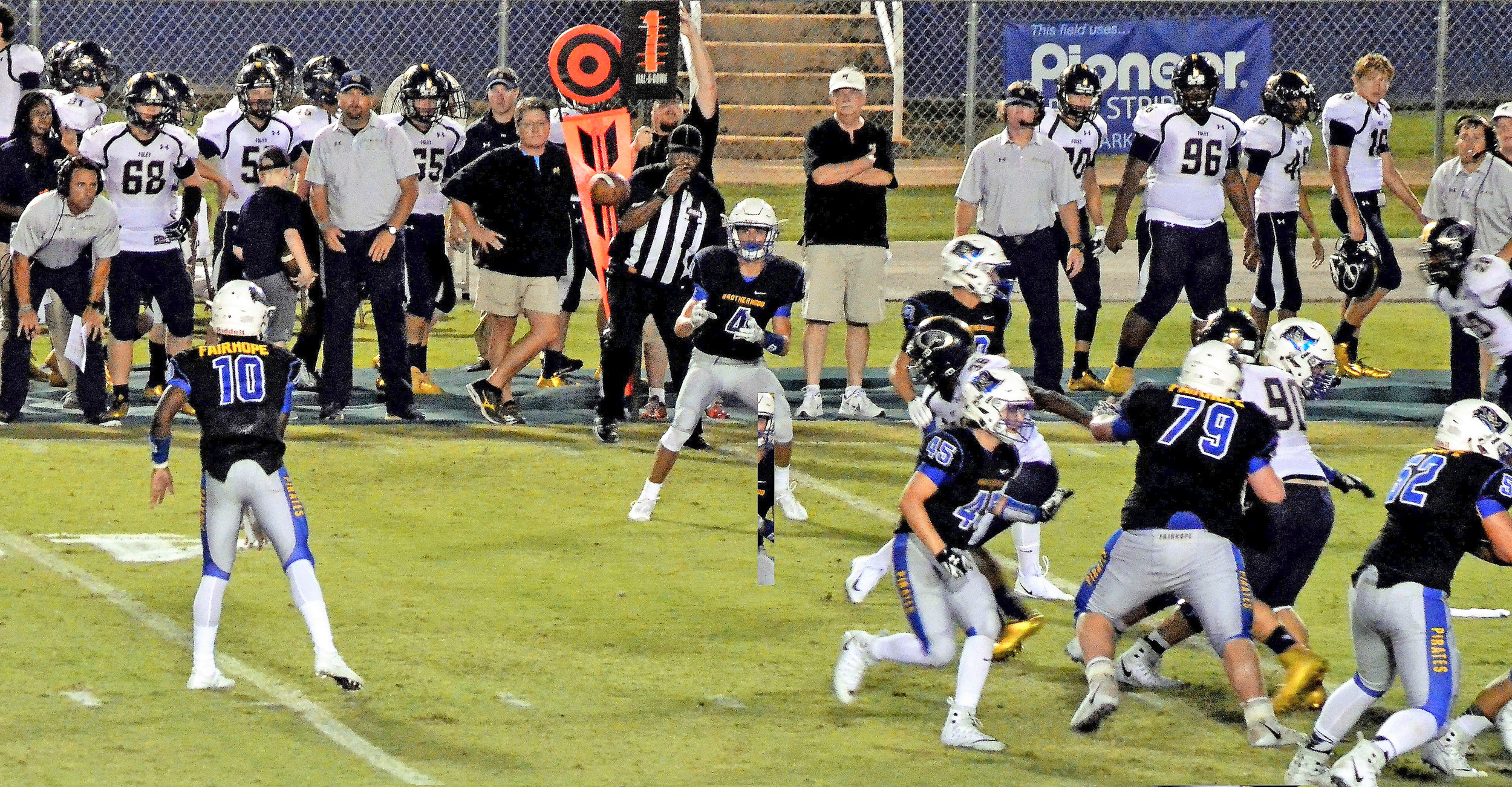 Devin Mitchell (10) fires a quick screen to Tanner Deeds for Fairhope as Foley coach Tad Niblett (left) looks on.