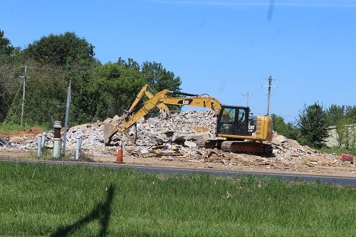 Crews continued work Thursday, Sept. 7 to clean up after the Robertsdale Livestock Auction building was leveled over the Labor Day weekend.
