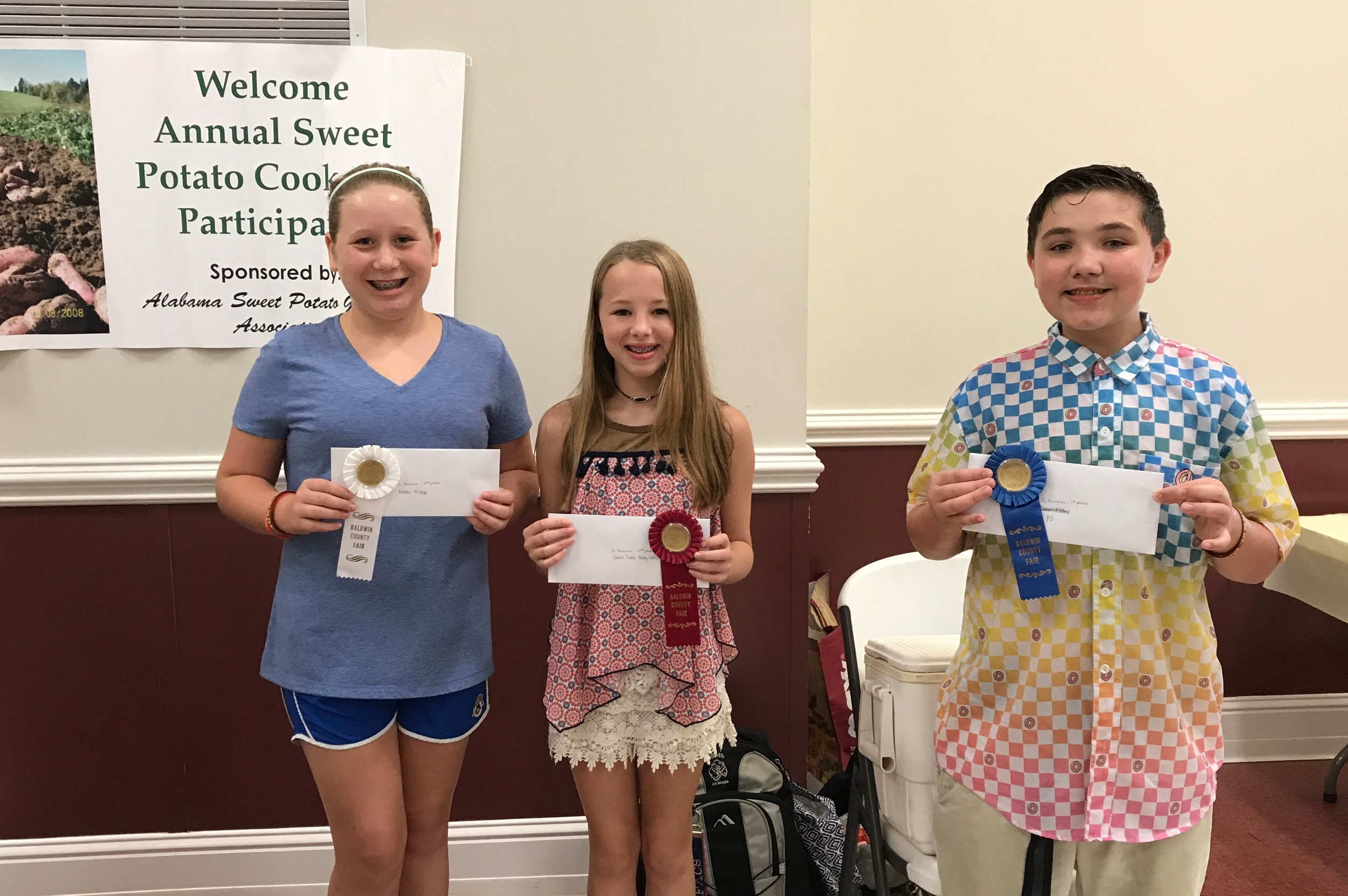Junior Division Winners in the Sweet Potato Recipe Contest are (l to r) 3rd place, Abbie Bishop; 2nd place, Georgia Paradise; and 1st place, PJ Dananer.