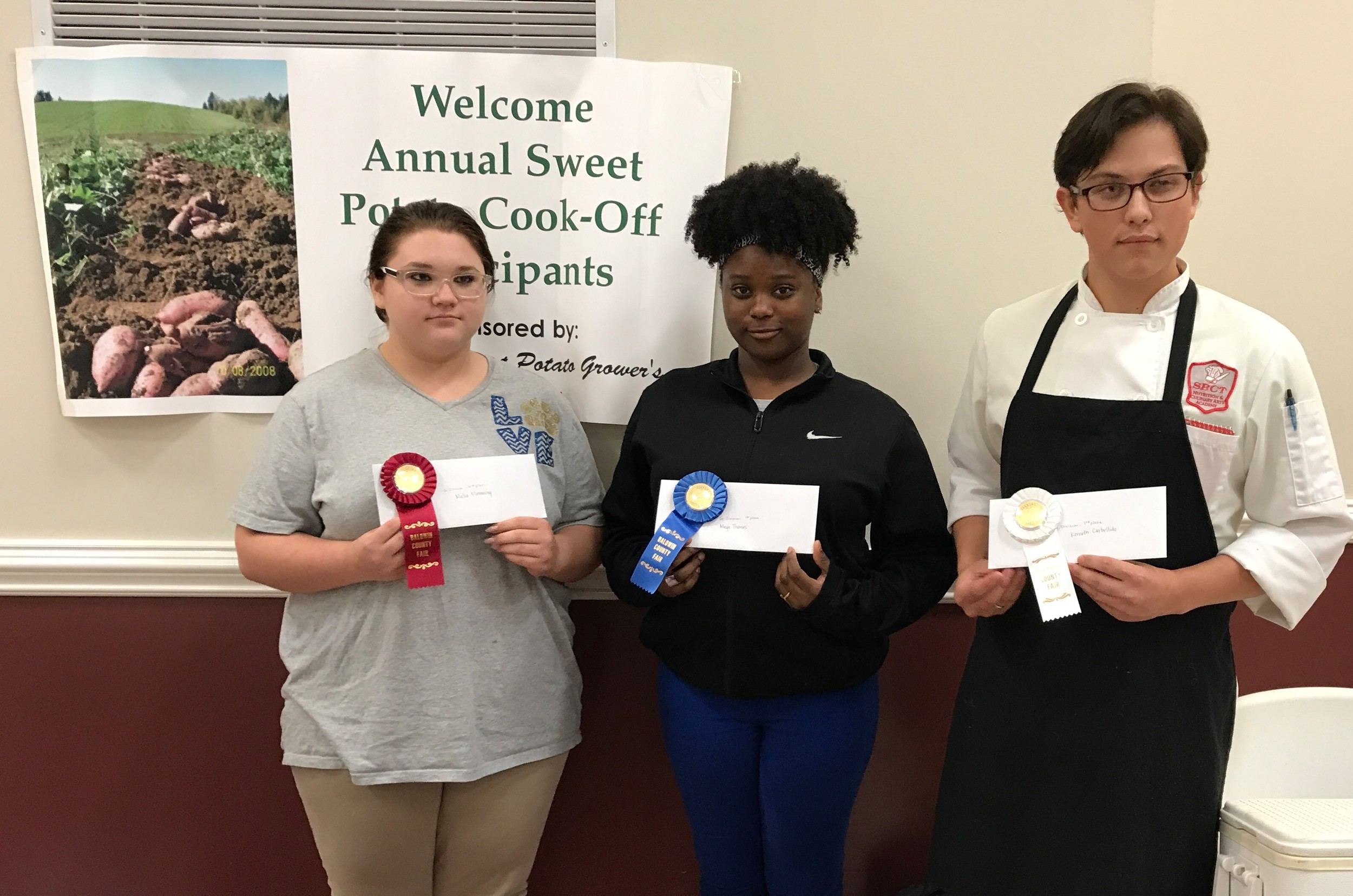Senior Division Sweet Potato Recipe Contest winners are (l to r) 2nd place, Malia Flemming; 1st place and Most Nutritious, Maya Thomas; and 3rd place, Kenneth Carbullido.