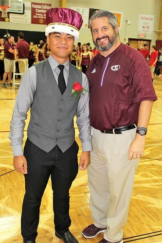 RHS Principal Joe Roh crowns Homecoming King Reinnel Magtanong during the pep rally Friday afternoon.