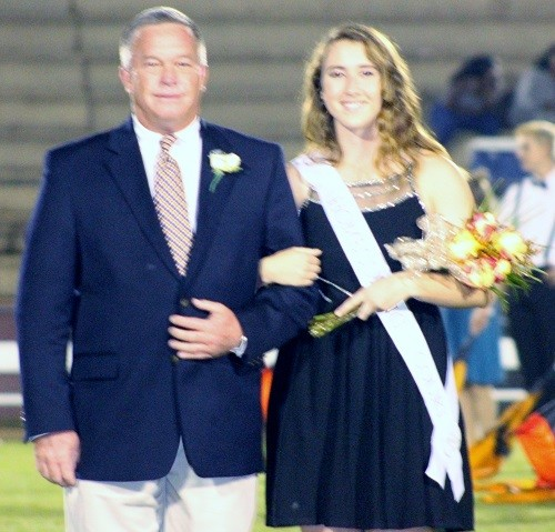 Senior Daizee Finley with escort Coach Barry Roberts.