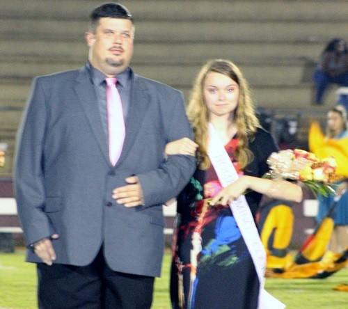 Senior Emyle Mann with escort Kevin Mann.