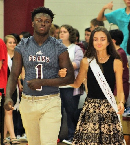 Junior Melody Weaver with escort Bryce Coleman.