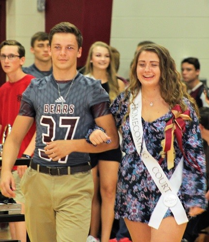 Sophomore Andy Taylor with escort Christian Coleman.