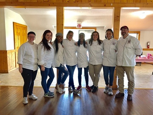 Students from the Robertsdale High School Culinary Academy serve guests at the Fork & Spoon tasting spree on Thursday, Oct. 19, a benefit for the RHS Alumni Association.