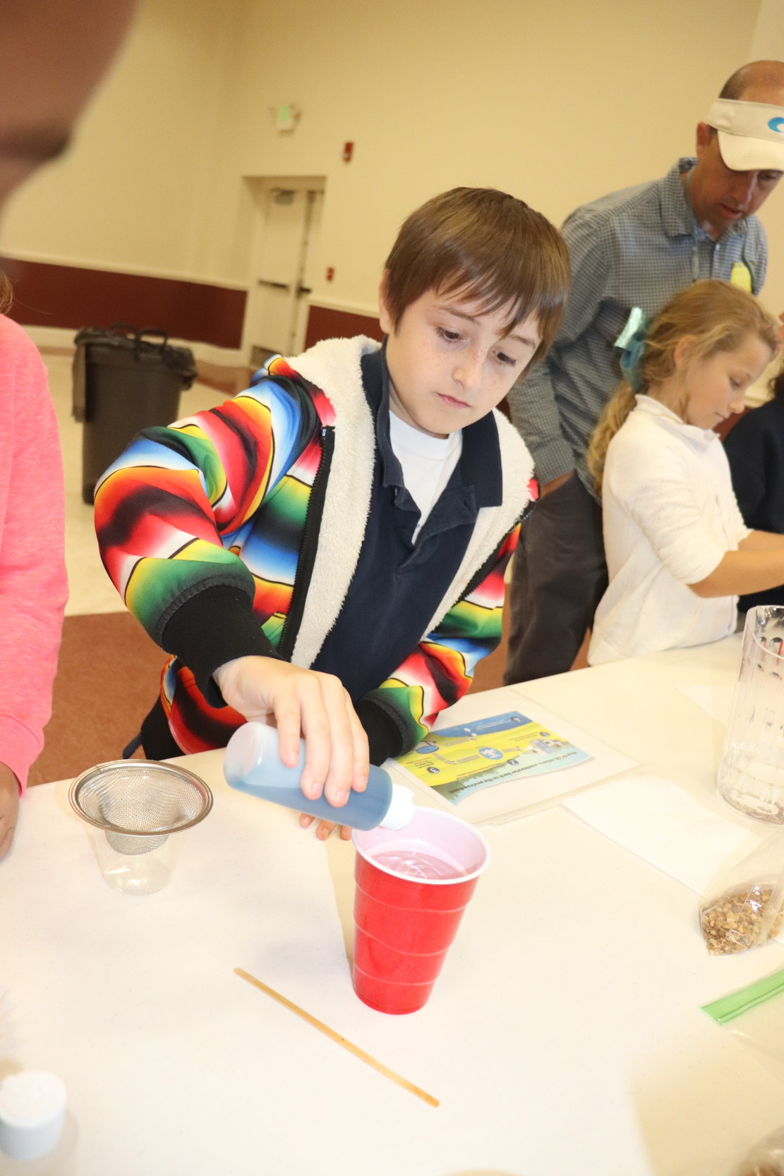 "Students add ""pollutants"" to their water."