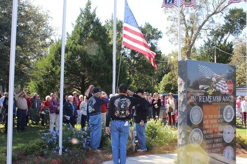A Veterans Day service was held Saturday at the Veterans War Memorial in Anderson Park which included the raising of the American Flag and lowering to half-staff. Those participating in the flag raising and lowering included Bill Coley, Charles Collins, Tommy Moss, Lew Rice and Frankie Kucera.