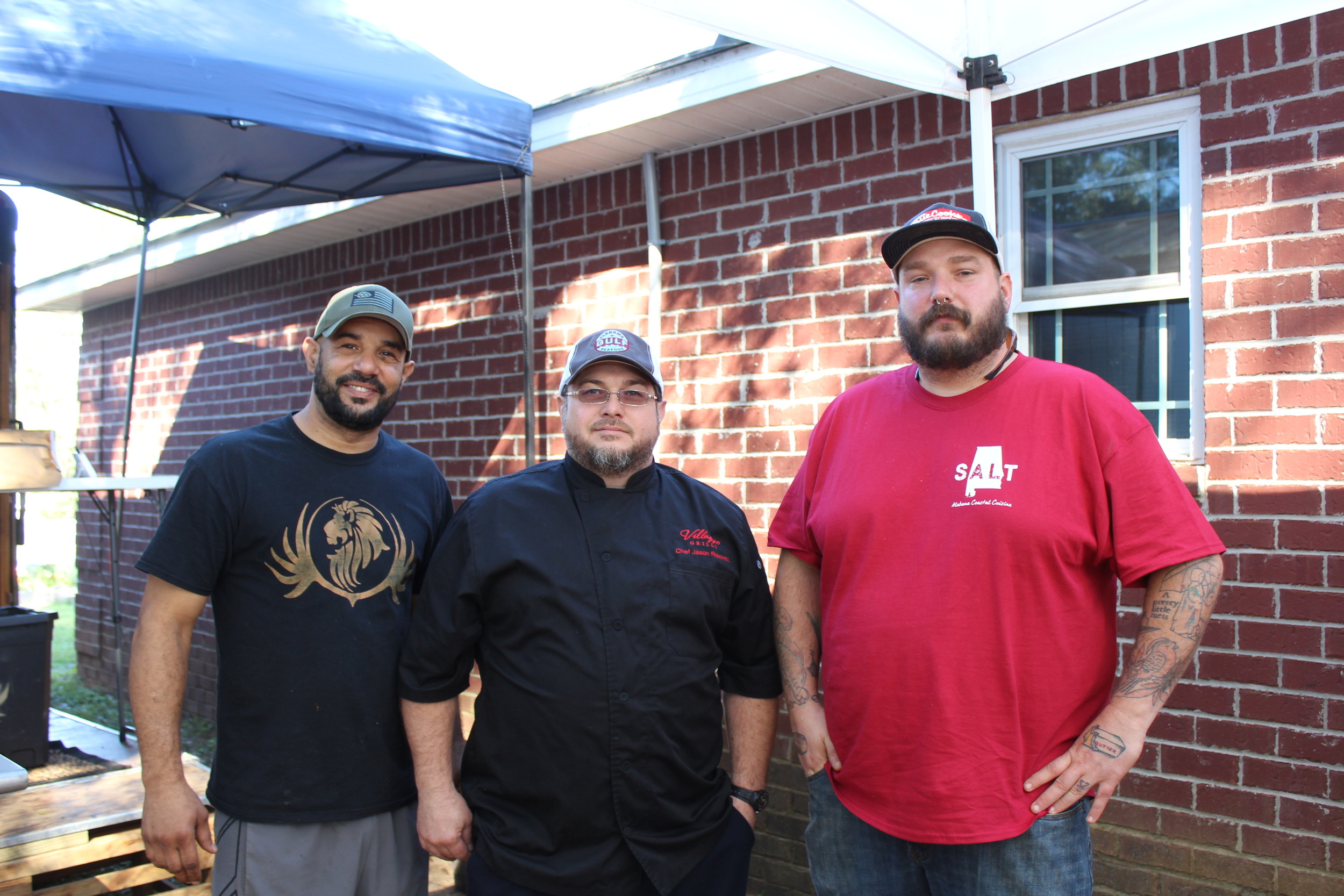 During the World Food Championship Herb & Pepper Farm becomes the hottest place for chefs to pick fresh produce. Pictured left to right are Chef Hiram Quintana, of The Lions Den, Jason Ramirez, Executive Chef of Villaggio Grille, Chef Roberts of SALT, who competed in the championship and regularly rely on Herb & Pepper for their produce.