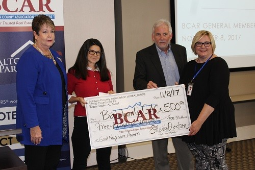 $500 donation to the Child Advocacy Center, C.A.R.E. House on behalf of this year's Good Neighbor Award winner, Rachel Romash of Elite Real Estate Solutions.