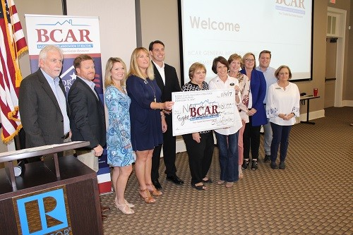 BCAR and MLS Board members present a check for $8,000 as part of this year's BCAR Disaster Relief.