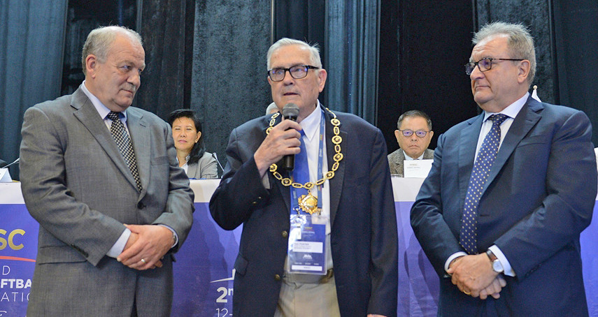 Don Porter, center, recently earned the World Baseball Softball Confederation's (WBSC) Collar of Honour. Porter was given the award by WBSC Softball Division Chairman Dale McMann, left, and WBSC President Riccardo Fraccari.