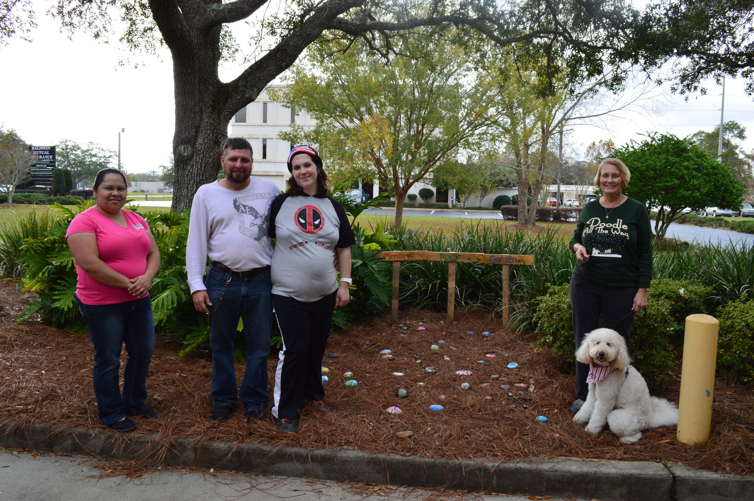 Pictured left to right: Sonia Cruz, Daniel Englert, Rachel Marotte, Lynda Folks (with her dog, Lottie May), have all contributed rocks to the Memory Rock Garden to honor special people and moments in their lives.