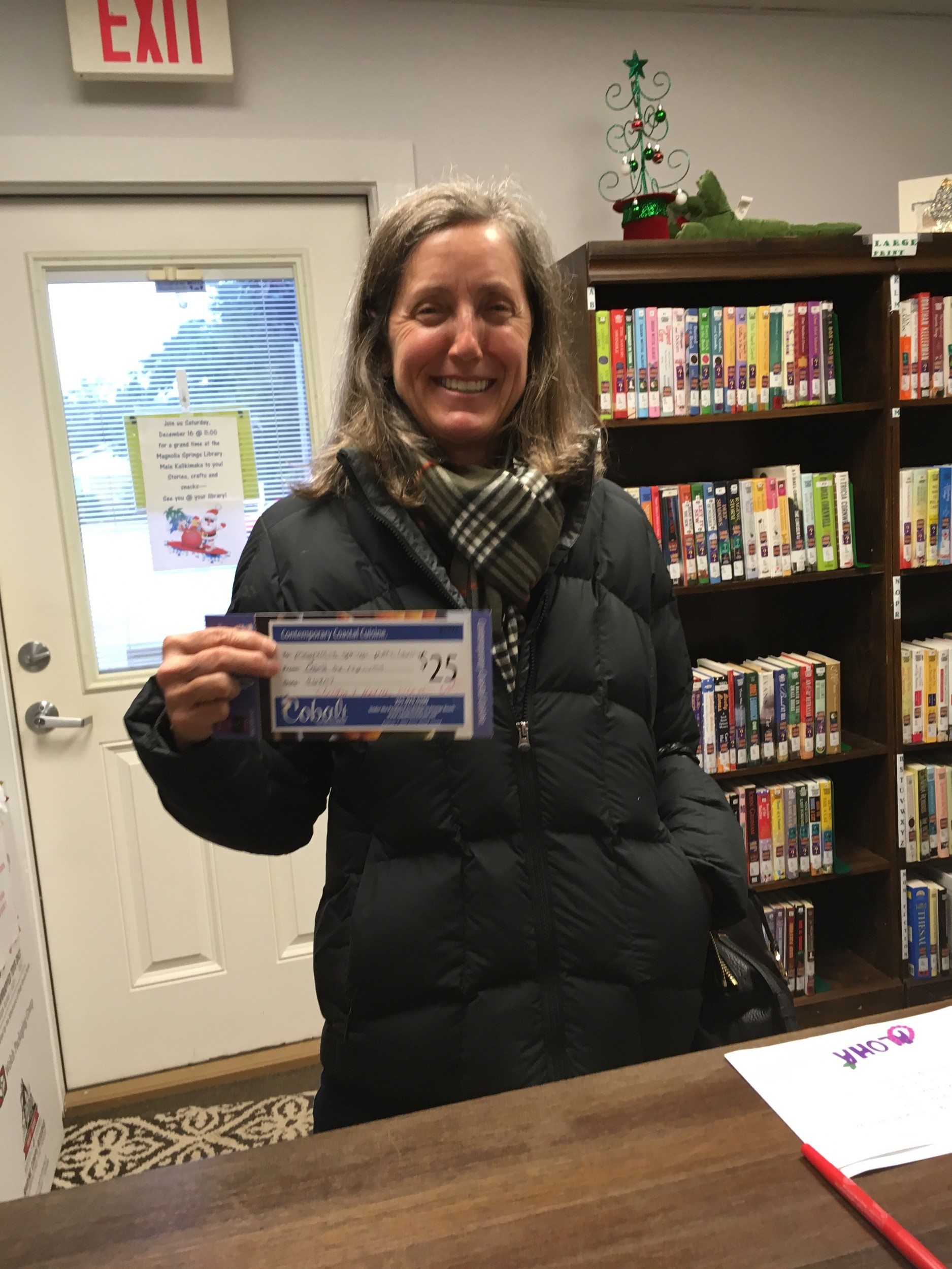 Proud supporter of The Magnolia Springs Library Kristin Weaver with her gift certificate to Cobalt's Restaurant.