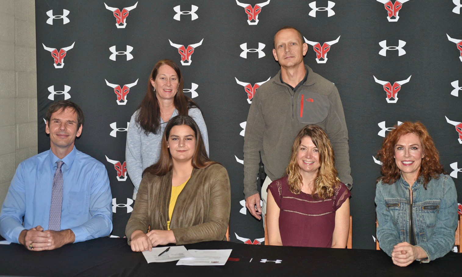 Seated from left are former (Three time) Olympian Gabor Mate, signee Alivia Busch, her mom Erica Busch and former Toros track and field coach Pam Swan. Standing from left is SFHS Girls AD Gretchen Boykin and Asst. SF Principle George Brown.